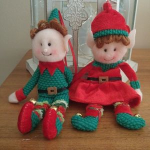 Boy and girl elf ornaments